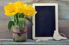 Tulips with blank blackboard Stock Image