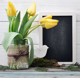 Tulips bouquet with blank blackboard Royalty Free Stock Photo