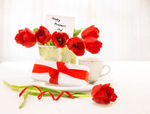 Tulips bouquet and coffee cup Royalty Free Stock Photography