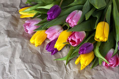 Tulips. Bouquet of tulips on a crumpled paper Stock Photo