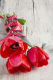 Tulips bouquet on wooden background.Space for text. Stock Photo