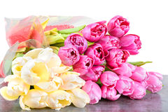 Tulips bouquets on the table Stock Images