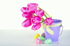 Tulips in a bucket . Tulips in a bucket with easter eggs Stock Photos