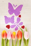 Tulips, butterflies and hearts Stock Photography