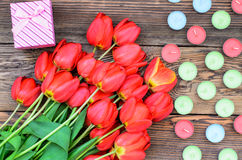 Tulips and candles Stock Photography