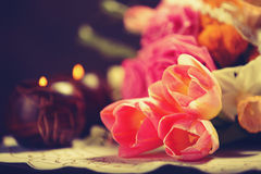 Tulips and candles Royalty Free Stock Photo
