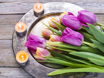 Tulips and candles. Spring background with tulips and candles Royalty Free Stock Photography