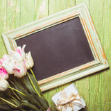 Tulips on chalkboard Royalty Free Stock Photo