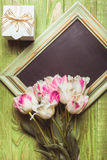 Tulips on chalkboard Royalty Free Stock Image