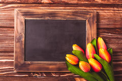 Tulips with chalkboard Royalty Free Stock Photography