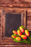 Tulips with chalkboard Stock Photos