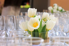 Tulips and champagne cups Stock Images
