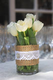 Tulips and champagne cups Royalty Free Stock Photos