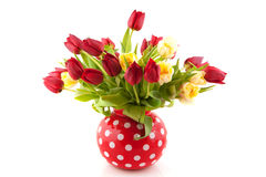 Tulips in cheerful vase Royalty Free Stock Photography