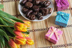 Tulips and Chocolate Candies Stock Photos