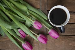 Tulips, coffee with notebook stock image
