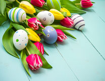 Tulips with colorful Easter eggs Royalty Free Stock Image