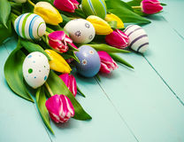 Tulips with colorful Easter eggs Royalty Free Stock Photography