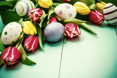 Tulips with colorful Easter eggs Royalty Free Stock Photo
