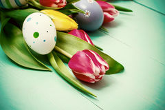 Tulips with colorful Easter eggs Stock Images