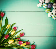 Tulips with colorful Easter eggs Stock Photography