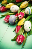 Tulips with colorful Easter eggs Stock Image