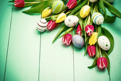 Tulips with colorful Easter eggs, top view Stock Image