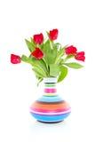 Tulips coloridos no vaso alegre Imagens de Stock