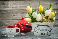 Tulips, cup and red polka dot teapot Stock Photography