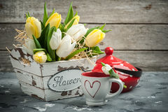 Tulips, cup and red polka dot teapot Royalty Free Stock Photo
