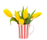 Tulips on cup Royalty Free Stock Photography