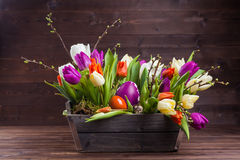 Tulips easter bouquet. On wooden background Stock Image