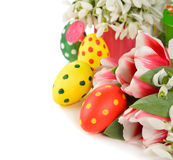 Tulips and Easter colored eggs Stock Photos