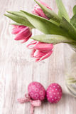 Tulips and Easter eggs on the table Royalty Free Stock Photos