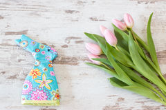 Tulips with egg cozy Royalty Free Stock Photo