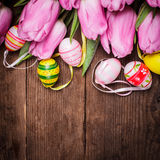 Tulips and eggs border Stock Photos