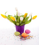Tulips with eggs Stock Images