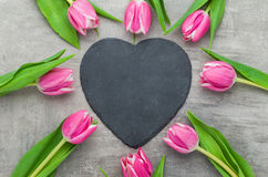 Tulips with an empty heart shaped sign Royalty Free Stock Photos