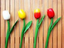 Tulips falsificados no fundo de madeira Imagem de Stock Royalty Free