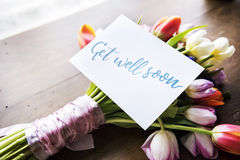Tulips Flowers Bouquet with Get Well Soon Wishing Card stock photos
