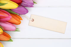 Tulips flowers in spring or mother's day with card on a wooden b Royalty Free Stock Images