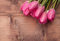 Tulips flowers on wooden table Royalty Free Stock Photo