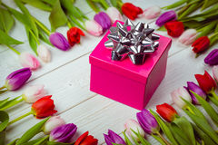 Tulips forming frame around gift Royalty Free Stock Photography