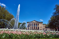 Tulips and fountain in front of the building of the Opera House Stock Photo