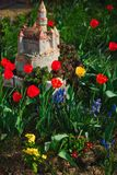 Tulips in the garden - model of castle - Spring is coming stock image