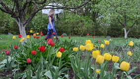 Tulips garden woman wet stock video footage