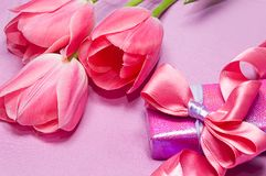 Tulips and gift box Stock Photography