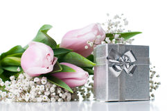 Tulips and a gift box Stock Image