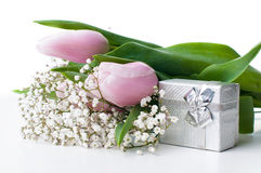 Tulips and a gift box Stock Images