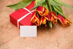 The tulips and gift box on cork floor. The tulips and gift box on a cork floor Royalty Free Stock Photography